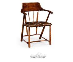 Walnut smokers chair with webbed leather seat (Arm) Satinwood necktie coffee table  #hpmkt #jcfurniture #jonathancharles #Furniture #InteriorDesign #decorex #CountryFarmhouse