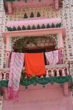 Pink afternoon with drying sarees