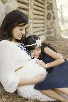 Mother and daughter maternity Photo By Essentia Photography