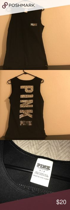 PINK black bling tank top!!! Super cute tank top in size small!! Runs big so if you are a medium you'll definitely fit as well. All black, and only worn once!! A big pink logo spelled with sequins is on the back above another pink logo. There is a small pocket on the front which also has the pink logo on it. Two small cuts on the side of the tank make it even more stylish. 100% cotton price is negotiable☺️ PINK Victoria's Secret Tops Tank Tops