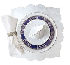 """""""Fez"""" scalloped placemat in silver, and """"Spectrum"""" embroidered linen napkin; both from Kim Seybert. """"Blue Pin Stripe"""" bone china dinner plate, teacup, and saucer; Wedgwood. Vintage Royal Doulton """"Byron"""" accent luncheon plate with platinum decoration"""