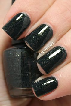 OPI Live And Let Die, a deep, dark blackened green with green and gold shimmer