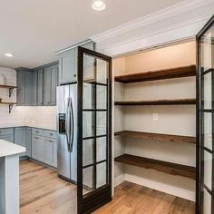 This traditional kitchen optimizes its space with a built-in pantry with . This traditional kitchen optimizes its space using a built-in pantry with glass doors and stacked salvaged wood shelving Kitchen Pantry Doors, Kitchen Pantry Design, Kitchen Wood, Glass Kitchen, Space Kitchen, Kitchen Pantries, Kitchen Shelves, Kitchen Cabinets, Kitchen Storage