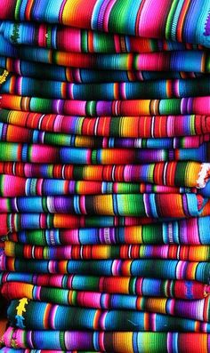 colors [I love these Mexican blankets. I have one with the emphasis on pink and dark green, and another in warm sunny pastels--light yellow, peach, pink,and turquoise, I think.]
