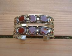 All good things come in a pair! Like these two beautiful stacking stone cuffs set in German silver and compressed maroon onyx stone.  size: Adjustable
