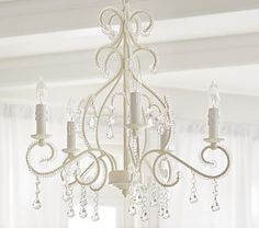 Because every little girl needs a fabulous chandelier.  White Lydia Chandelier Pottery Barn Kids