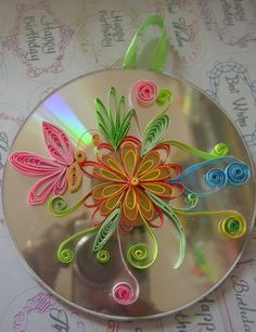 Quilling design on waste cd