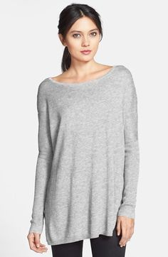 Long sweater to wear with leather leggings! Elongated, rib-knit cuffs extend to the elbows of this extra-cozy relax-fit pullover. Slits at each side offer further contemporary style. By Trouvé