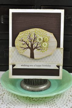 Love the combination of stamped balsa woord over woodgrain background paper.