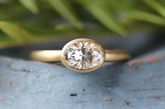Love this 7x5mm Oval Solitaire Engagement Ring! Perfectly versatile and minimal, great on its own or stacked with a wedding band. Pictured in matte 10k yellow gold with a Forever One Moissanite center stone.