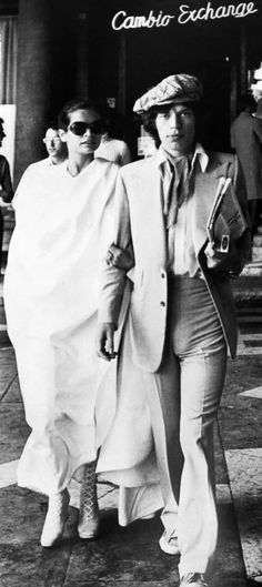 Bianca and Mick Jagger. Love her boots