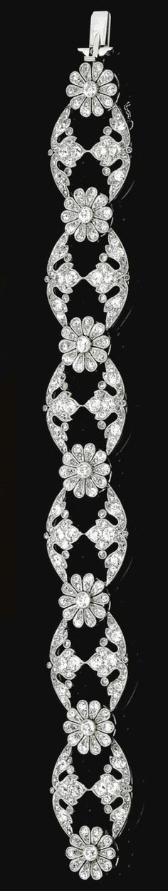 A bracelet of open work and floral design, millegrain set with rose-, single- and circular-cut diamonds, bracelet length approximately 170mm