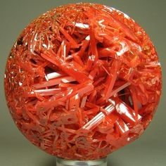 Crocoite | Australia - Tasmanie | 7.5 cm Wow, Crocoite is one of my favorites, and I've sold many specimens.  However, I've never seen it carved into a sphere before.  This is awesome!
