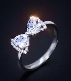 sterling silver and sparkle CZ bow ring http://www.jewelsin.com/p-stunning-gift-bling-cz-bow-ring-for-girls-1358