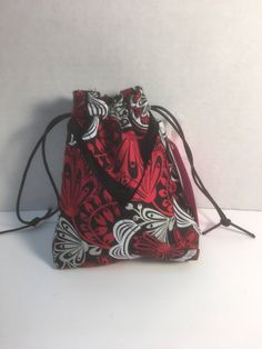 A personal favorite from my Etsy shop https://www.etsy.com/listing/531685805/black-and-red-drawstring-bag