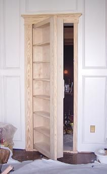 "secret passageway. I want to do this with the door from Paul's ""Man Cave"" to the closet. It looks awesome and adds lots of storage!"