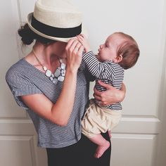 Nautical with a smart hat and proving a baby doesn't mean obesity.