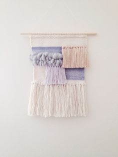 Bumpy hand woven wall hanging measures 9 inches x 13 inches. wooden dowel measures 12 inches A mix of Hand dyed wool, alpaca, silk, bamboo,