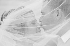 Groom bride beach wedding nose kiss under veil