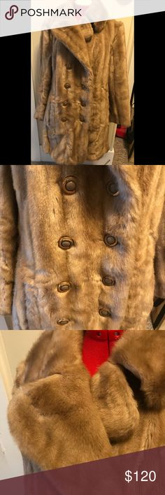 """Vintage Faux Fur Coat Grandella by Fairnoor Lovely vintage faux fur coat by Grandella styled by Fairmoor. It says to clean by fur coat method. I believe this to be Tissavel from France. I am listing two other coats that look similar but are marked and this one is not. This coat is in beautiful condition. The only problem I see is some cracking of the lining inside the lapel and down behind the button holes. The coat measures 15"""" across the shoulders, a 38"""" bust and 33"""" from shoulder to hem…"""