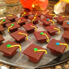 Made these little guys for my graduation party! Used after dinner mints for the top, a reeses cup for the bottom (with a drop of icing in between), then we put a stream of icing for the tassel and a mini M for the button. People LOVED them! So DELICIOUS!