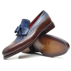 Kiltie style wingtip tassel loafer for men Dark Brown & Navy two tone handpainted calfskin upper Antiqued double leather sole Bordeaux leather lining and inner sole This is a made-to-order product. Please allow 15 days for the delivery. Because our products are hand-painted and couture-level creations, each item will have a unique hue and polish, and color may differ slightly from the picture. Color: As Per Description Material: Calfskin Item Fit / Dimensions: As per size guide Made In…
