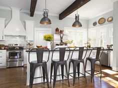 This #kitchen is a thing of dreams with its large island, countertop seating and wood beams on the ceiling