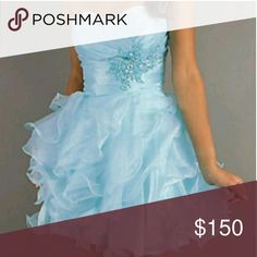 Deal of the Day New Alyce size 4 homecoming This is a light blue strapless cocktail dress that has a ruffle skirt and a group of beads at the waist. Alyce Paris Dresses Strapless
