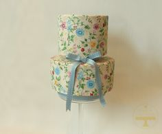 A hand painted, two tier cake, inspired by beautiful vintage textiles