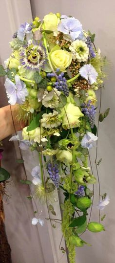 l just love the choice of flowers in this gorgeous cascade bouquet. Especially the Passion Flower. How appropriate.