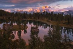 Dreamy evening - Beautiful lake in the heart of Dolomites.  More on <a…