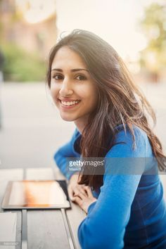 Side view portrait of happy teenager leaning on table outdoors  **This is how I envisioned young Zibah. A natural beauty.