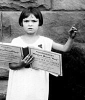 Six year old Lorraine Miles leads Sacred Harp shape-note singing in Texas, 1931.