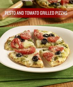 Break out of your traditional grillin' recipes and dish up this recipe for Pesto and Tomato Grilled Pizzas! Stewed tomatoes, ripe olives, cheese and pesto top a flatbread crust that's grilled to perfection.