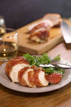 Prosciutto-wrapped chicken stuffed with a herb ricotta. Everything is perfect about that sentence!