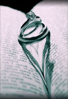 Heart shadow with wedding rings on bible