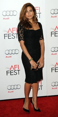 Eva Mendes in a smoldering strapless Gucci gown with Le Vian bangles and Bavna earrings during the Rome Film Festival.