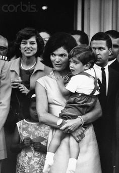 Jackie Kennedy with John and Kennedy Sister. Agent Paul Landis and Clint Hill are beside and behind her.