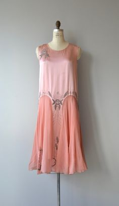 Glorious vintage/antique 1920s rosy pink silk dress with classic 1920s shape, silver floral beading at the shoulder, silver beading around the waist at both front and back, airy chiffon skirt with repeated beading. A treasure to be sure. --- M E A S U R E M E N T S ---  fits like: medium bust: 35-36 waist: up to 37 hip: up to 42 length: 45 brand/maker: n/a condition: a faint stain at one side of the skirt, see close up photo  to ensure a good fit, please read the sizing guide: ...
