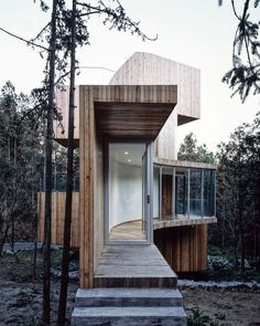 """upknorth:  """" All glass and timber; Modern mountain 'tree house'.  """""""