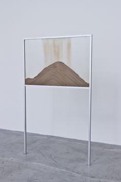 "Nicholas Mangan, ""A World Undone "", 2012. Zircone, glass, metal, film on HD colour, silent, loop. 150 x 90 x 3 cm"