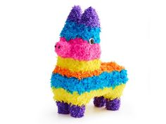 Pinata Cake : Don't take a whack at this guy — he's dessert! To make the edible donkey, Food Network Magazine stacked chocolate loaves for the body and attached ice cream cones for the legs, ears and snout.