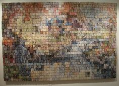 "Amanda Nelsen -- Book Artist and Binder ""Kinkade Recycled"" (Mountain Retreat)  This 8 by 5 foot wall hanging is comprised of approximately 40,000 pieces of junk mail, folded and string bundled into 2 inch cubes to create colored pixels."