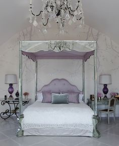 The shimmer of mirrored furniture makes this glamorous lavender bedroom so inviting