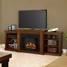 Snuggle up to modern convenience with this electric fireplace and console. With side shelves for your books or entertainment accessories, this unit has a sturdy top to accommodate a flat-panel TV. The remote controlled fireplace keeps you comfortable.