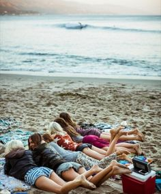 Sunset Beach I would give anything to be one of those girls laying there by the ocean