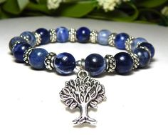 About the Bracelet A beautiful tree of life bracelet with natural blue sodalite which is said to promote calm and peace. Bracelet Details: This blue tree of life bracelet is made with: ♥ 8mm Blue Soda