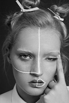 Black and white shoot, minimalist white geometric make up. Love the half lip outline!