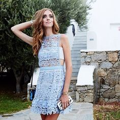 @chiaraferragni at Mykonos wearing LACE PEPLUM MINI DRESS. This style is back in stock now with ad...
