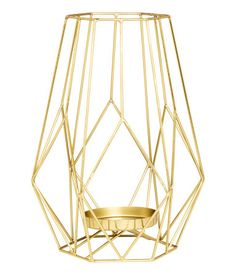 Gold-colored. Large metal candlestick designed to hold pillar candles. Diameter of candle holder 3 in. Width 6 3/4 in., height 9 1/4 in.